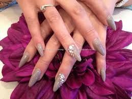 stiletto nails with wild mink gel polish and swarovski crystals on