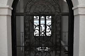 entrance door in glass and wrought iron design greek venetian