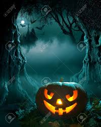 halloween design glowing pumpkin in a dark scary forest church