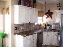 granite countertop white kitchen cabinets and dark wood floors