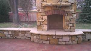 stone fireplace and walls with brick patio installed by josh link