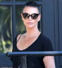 hair buzzed and growing out stages pics charlize theron bravely steps out after new buzz cut reveals salt