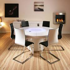 large round white gloss dining table and six white black dining