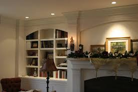 hand made fireplace mantle surround and bookcase by precision