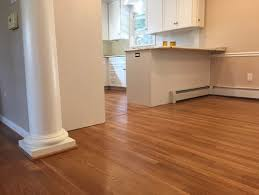 kitchen remodel shoe molding to match cherry floor or white cabinets