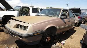car junkyard michigan junkyard treasure 1984 pontiac 2000 sunbird s e turbo autoweek