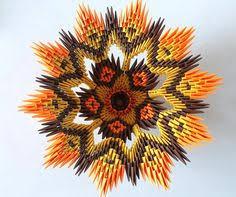 tetera en origami con módulos de kumitate sirviendote