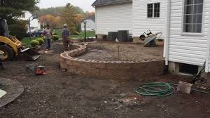 laying a paver patio building a raised paver patio youtube