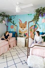 modern ranch house girls whimsical bedroom classy clutter my girls totally love their room they hang out in there all day long we put up the wall mural and the beds on christmas eve and we surprised them on