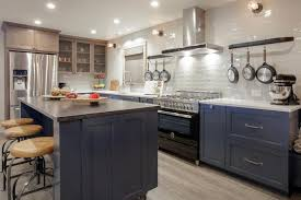 white kitchen cabinets with blue subway tile light and bright kitchen with blue cabinets and white subway
