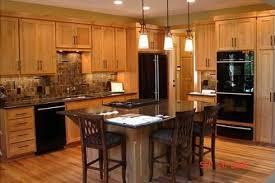 kitchen color ideas with oak cabinets and black appliances designed by teri larsen trendy kitchen backsplash oak