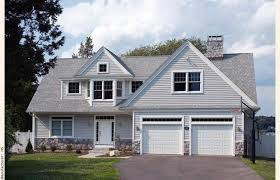cape cod house plans with attached garage cape cod house garage in front an achitect designed cape cod