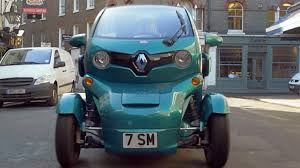 renault twizy blue sir stirling moss drives a turquoise renault twizy in london