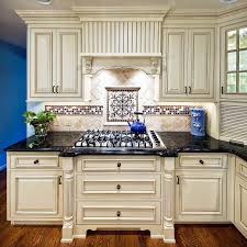 kitchen style ivory ceramic tile backsplash white distressed ivory ceramic tile backsplash white distressed cabinets black granite countertop hardwood floors victorian kitchen remodeling blue kettle