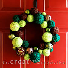 the creative imperative yarn wrapped ornament jingle bell wreath