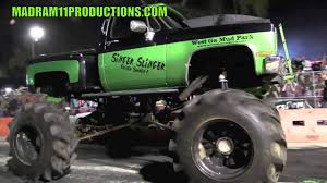 monster trucks in mud videos the singer slinger monster truck creates one hell of a smokeshow