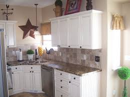 outstanding kitchen backsplash white cabinets brown countertop