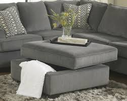 sectional sofas living spaces loric 12700 smoke grey sectional sofa living spaces ashley home