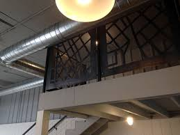 loft cable railing with steel panels u2014 fossil forge design