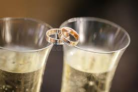 glass wedding rings wedding rings lie on chagne glasses stock photo image of ring