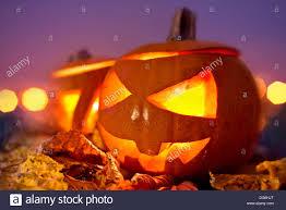 halloween evening jack o lanterns at dusk on halloween stock