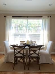 neutral dining room designed by jessica bechtel naples fl