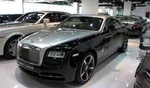 roll royce dubai mclarens at deals on wheels new showroom in dubai dubaidrives com