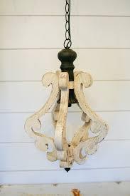 distressed cream scroll chandelier the magnolia market