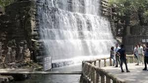 huge waterfall tourists walk by rock garden of chandigarh india