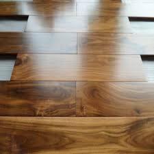 china foshan factory cheap prefinished golden acacia hardwood