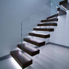 floating stairs in dark finish led lights under each tread with