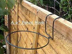 Flower Pot Holders For Fence - wire hangers used as pot hangers decorate an ugly chain link