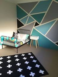 create fun patterns with painters tape to make any room more