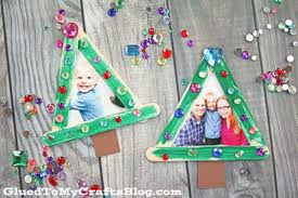 popsicle stick tree frame ornaments glued to my crafts