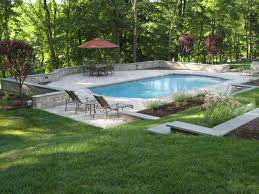 decorative small backyard pool with simple umbrella and 4 sunbed