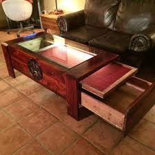 this is a cedar coffee table w a display on top and a 50