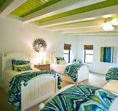 good looking bedroom with low ceiling with artsy bed sheets also