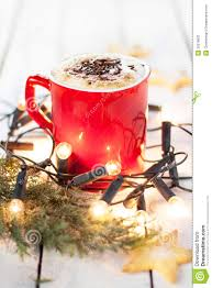 Red And White Christmas Lights by Winter Coffee In A Red Mug With Christmas Lights And Cookies Stock