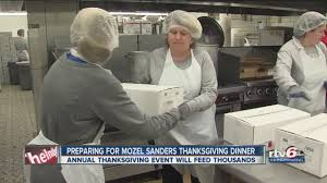 volunteers prepare for mozel sanders thanksgiving dinner
