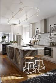 reclaimed wood kitchen island what s not to about this kitchen gorgeous kitchens