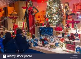 paris france children window shopping french department store