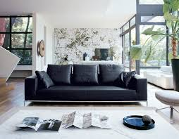 decorating a living room with black leather furniture