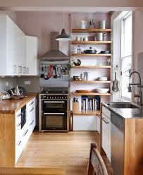 small kitchen design ideas home interior and exterior small contemporary kitchen idea london with flat panel cabinets white wood countertops gray backsplash porcelain medium tone hardwood