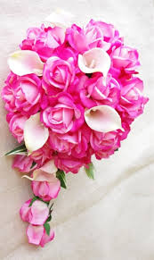hot pink roses touch fuchsia pink roses calla lilies cascading bouquet