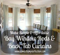 How To Hang Curtains On A Bay Window Diy Bay Window Curtain Rod For Less Than 10 Diy Bay Window