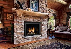 interior brown wooden fireplace mantel of brown stone fireplace