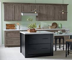 maple cabinets with black island laminate kitchen cabinets kemper cabinetry