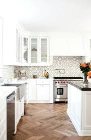 blue kitchens with white cabinets glass tile backsplash with white cabinets kitchen white cabinets