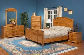 blue boys bedroom with small bed and natural pine floors amazing
