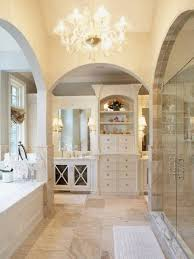 traditional bathroom designs with chandelier and walk in shower